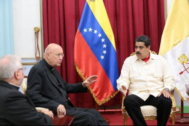 Archbishop Claudio Maria Celli, seen here speaking with Venezuelan President Nicolas Maduro, said leaders have to show that these are not biblical times and signal that they understand that dialogue is the only way to solve the country's problems. Photo courtesy of Prensa Presidencial