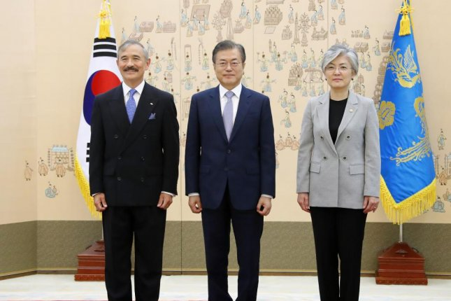 U.S. Ambassador to South Korea Harry Harris (L) made inappropriate remarks to the media, the office of President Moon Jae-in (C) said Friday. File Photo by Yonhap/EPA-EFE