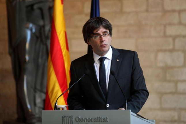 Catalan President Carles Puigdemont rejected calls Thursday for regional elections as a means to head off the Spanish government's taking direct control of the region. Photo by Toni Albir/EPA