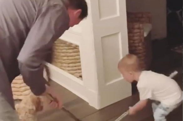 Wayne Gretzky plays hockey with his 1-year-old grandson River Johnson. Photo courtesy of Paulina Gretzky/Instagram