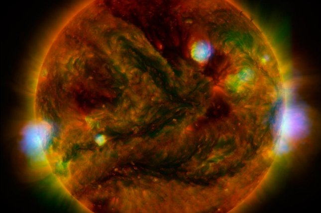 Flaring, active regions of the sun are rendered in a new image combining observations from several telescopes. Photo by NASA/JPL-Caltech/GSFC/JAXA