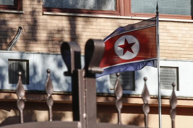 The North Korean flag flies inside North Korea's embassy compound in Rome on Thursday. Photo by Giuseppe Lami/EPA-EFE
