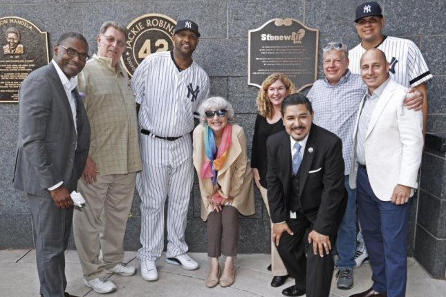 The New York Yankees added a plaque in Monument Park commemorating the historic Stonewall Inn Tuesday at Yankee Stadium. Yankee players CC Sabathia (L), Dellin Betances (R) and general manager Brian Cashman (far right) attended the ceremony. Photo courtesy of the New York Yankees