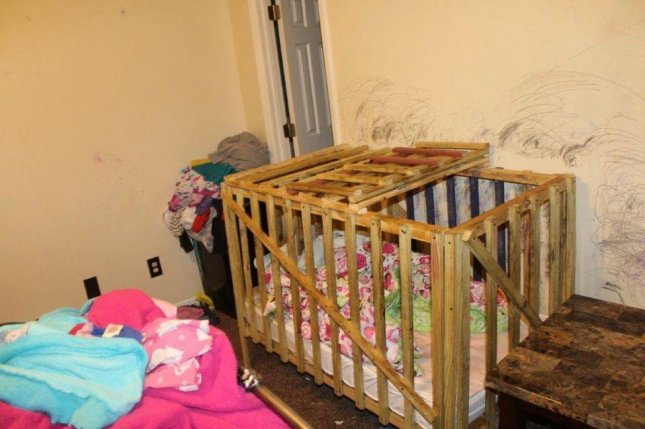 Police in Alabama arrested three people after finding evidence that they repeatedly locked children between the ages of 8 months and 11 years old in makeshift cages. Photo courtesy Lee County Sheriff's Office