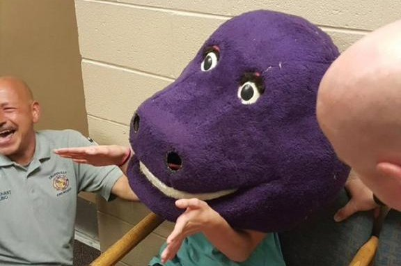 Firefighters rescue teenager trapped in 'Barney' dinosaur mask - Look: Teen Girl's Head And Shoulders Stuck In Barney Mask - UPI.com