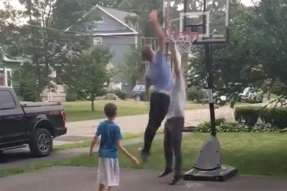 Crew Ainge dunks on his dad, Boston Celtics general manager Danny Ainge, in his driveway Sunday as part of the #drivebydunkchallenge. Photo courtesy of Danny Ainge/Twitter