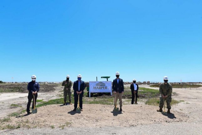 U.S. Navy officials and the owner of Harper Construction, which will build the Directed Energy Systems Integration Laboratory, pictured at a May 5 groundbreaking for the lab. Photo by Dana White/U.S. Navy