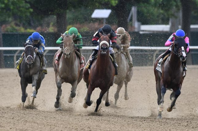 Keen Ice (green silks) takes aim on Shaman Ghost (black and red) en route to upsetting that rival in Saturday's Grade I Suburban at Belmont Park. Photo courtesy of Robert Mauhar/NYRA