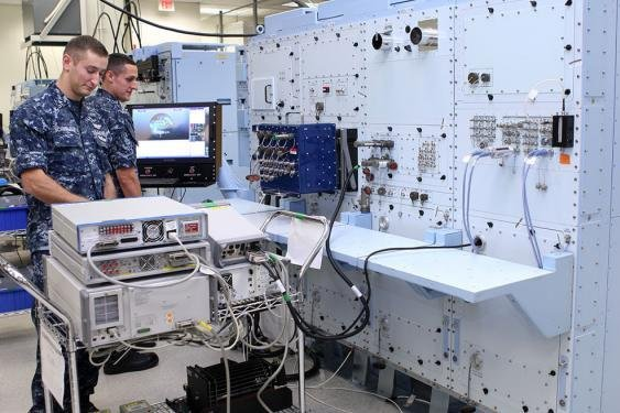 Sailors operating the eCASS aircraft diagnostic system. Photo courtesy of the U.S. Navy