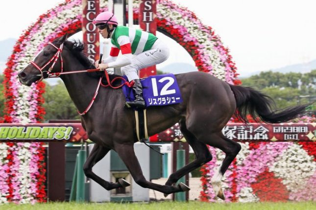 Lys Gracieux, seen winning this year's Grade 1 Takarazuka Kinen, is in the mix for Saturday's Group 1 Cox Plate in Australia. Photo courtesy of Japan Racing Association
