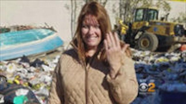 A Long Island woman dug through piles of garbage at her local dump after she accidentally threw her wedding rings away. Colleen Dyckman searched for four hours along with Babylon Recycling Center employees Jeremy Aretakis and Kim Weathers until the rings were discovered. Screen capture/ Inside Edition/NDN