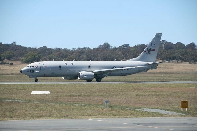 A P-8A Poseideon, made by Boeing and part of the U.S. Navy, takes off from Australia in 2014. Boeing has been awarded a contract with the Defense Logistics Agency to supply P-8 spare parts. Photo courtesy YSSYguy/Wikimedia