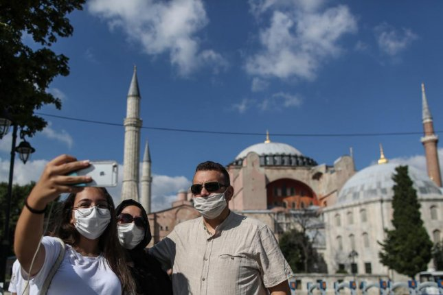 People take pictures as they celebrate Turkey's decision that the 1,500 year old Unesco World Heritage site Hagia Sophia can be converted into a mosque, in front of the Hagia Sophia, in Istanbul, Turkey Saturday. Turkey's highest administration court on Friday ruled that the museum that was once a mosque built in a Cathedral can be turned into a mosque again by anulling its status as museum. Photo by Erdem Sahin/EPA-EFE