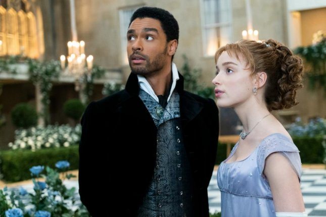 Rege Jean-Page and Phoebe Dynevor star in Bridgerton. Photo courtesy of Netflix
