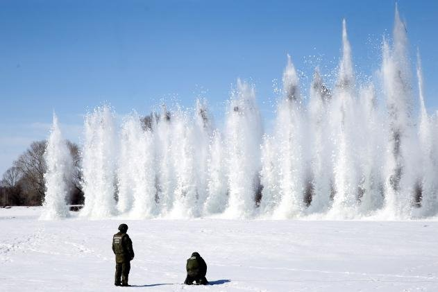 Military engineers conduct an ice blasting operation on the Biya River in Biysky District, Altai Territory, Russia, on Friday.Photo by Kirill Kukhmar/TASS