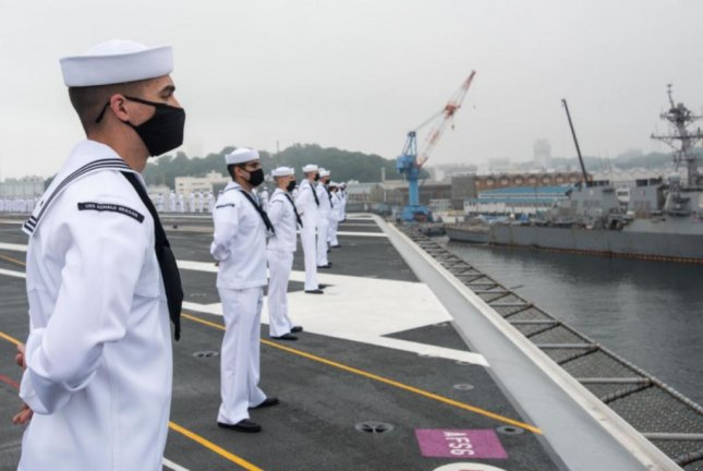 Sailors aboard the aircraft carrier USS Ronald Reagan man the rails as the vessel departed Naval Base Yokosuka, Japan, on Wednesday. Photo courtesy of U.S. Navy