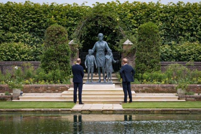Britain's Prince William (L) and Prince Harry are seen at Kensington Palace in London on Thursday during the unveiling of a statue of their mother, Princess Diana. Photo courtesy Duke and Duchess of Cambridge/Twitter