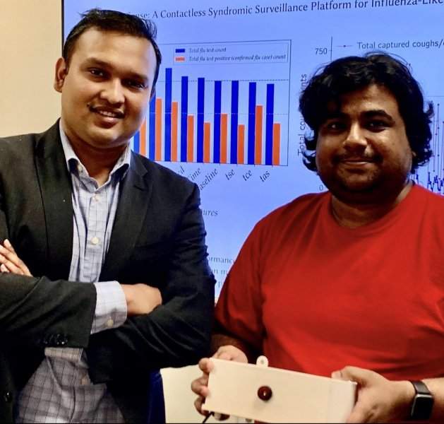 Tauhidur Rahman, left, and Forsad Al Hossain display the FluSense device they invented. Photo courtesy of University of Massachusetts Amherst