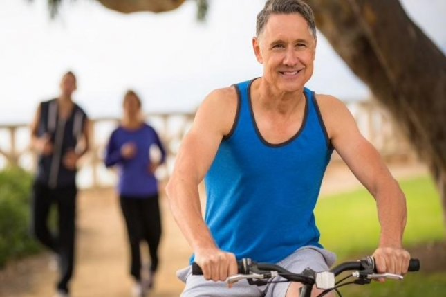 Exercising regularly, eating a balanced diet, not smoking, and drinking moderately may cut the odds of Alzheimer's, the study found. Photo courtesy of HealthDay News