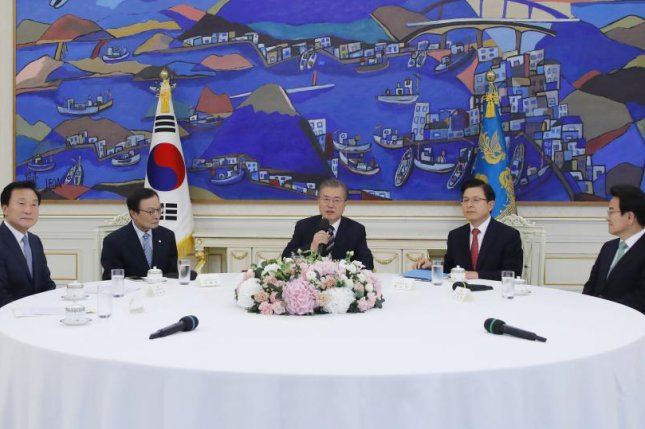 South Korean President Moon Jae-in (C) speaks during a meeting with ruling and opposition party leaders about an ongoing South Korea-Japan trade conflict at the presidential office in Seoul on Thursday. Photo by Yonhap/EPA-EFE
