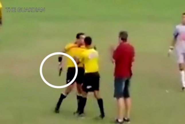 Referee Pulls A Gun During Dispute At Soccer Game In Brazil