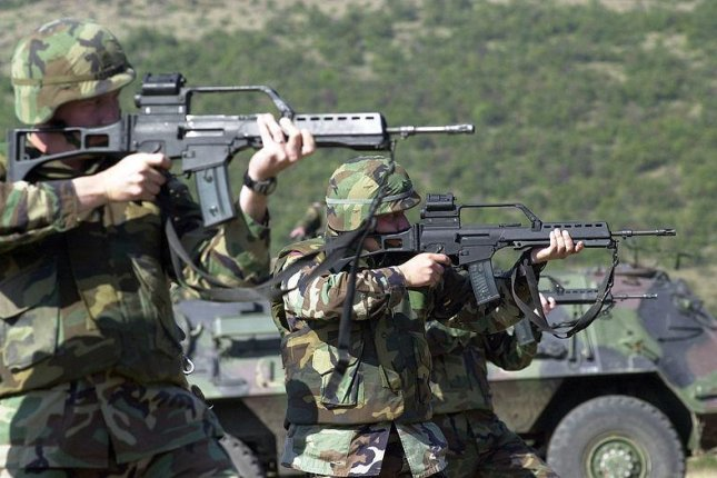 U.S. Army soldiers cross-train with G-36 rifles in Kosovo. U.S. Army photo by SSG Vincent A. King.