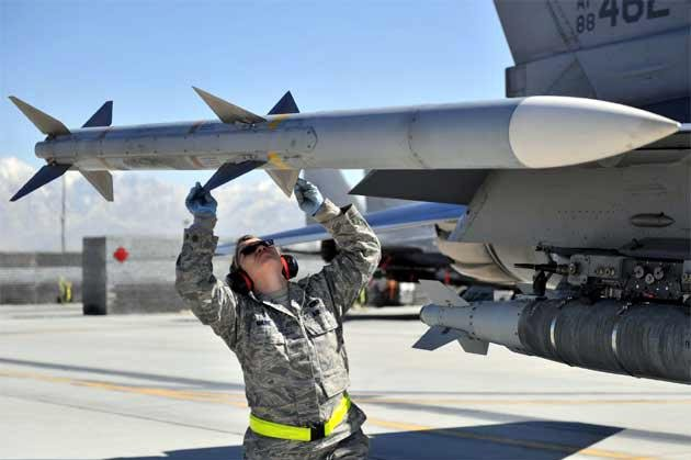 A Stinger missile being loaded onto an aircraft. U.S. Air Force photo
