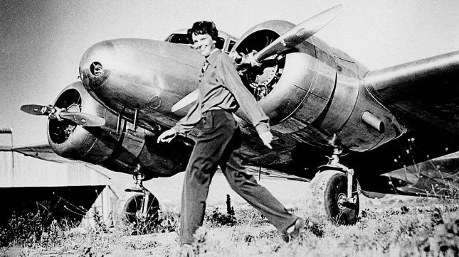 Amelia Earhart and her Electra aircraft.
