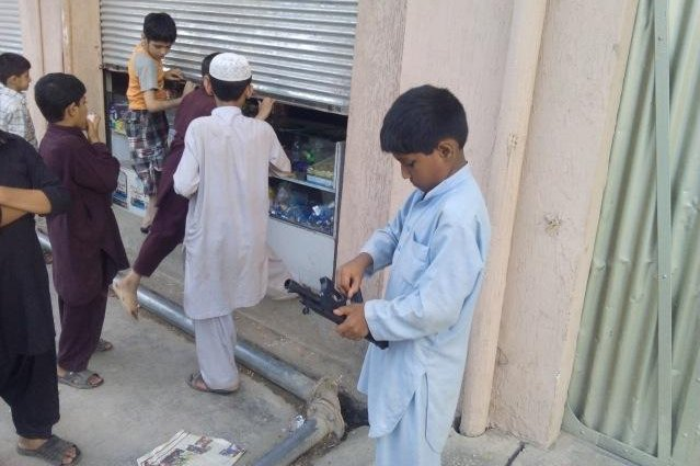 Boys in Peshawar play with toy guns before Eid. There is a campaign to ban the toys. Photo by Inam Ullah/News Lens Pakistan