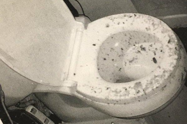 Baltimore resident Angela Wright's toilet after it backed up in an explosion of feces. Screenshot: WBFF-TV