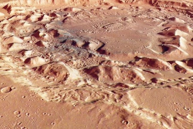 A perspective view of Ismenia Patera, an unusual and dynamic crater found on Mars. Photo by ESA/DLR/FU Berlin