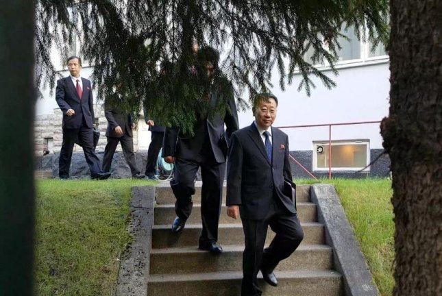 North Korean delegates, including top negotiator Kim Myong-gil, leave the country's embassy in Stockholm on Saturday to attend a meeting with U.S. officials to prepare for formal working-level nuclear talks. Photo courtesy of Joint Press Corps/Yonhap