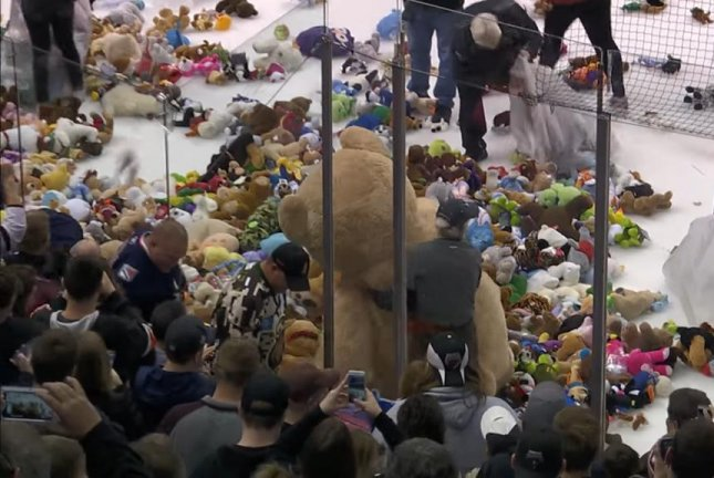 Teddy bears rain onto the ice during a Pennsylvania hockey team's teddy bear toss event. Screenshot: TheHersheyBears/YouTube
