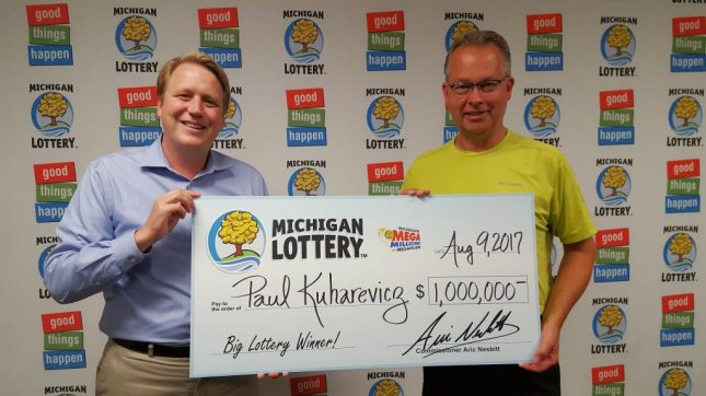 Paul Kuharevicz wound up purchasing a $1 million winning lottery ticket after his flight home from a business trip was canceled. Photo courtesy of Michigan Lottery