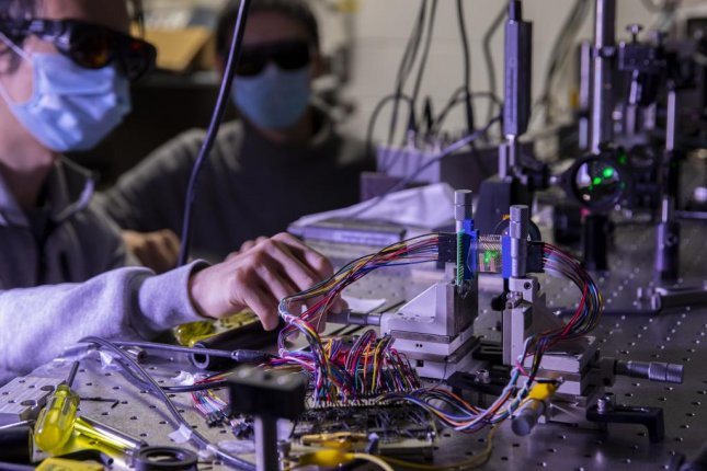 Researchers paired graphene detectors and a neural network to create motion-sensing technology that could be used in autonomous devices like self-driving cars and manufacturing robots. Photo by Robert Coelius/Michigan Engineering, Communications and Marketing