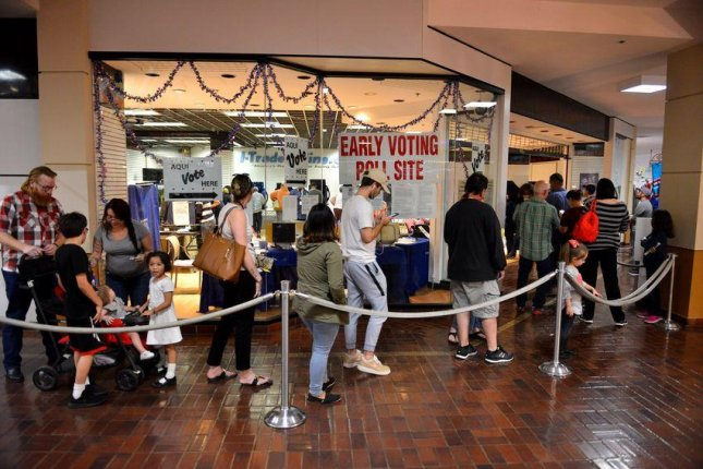 A long line of voters wait to cast their ballots at the Wonderland of the Americas Mall in San Antonio during early voting. Photo by Robin Jerstad for The Texas Tribune