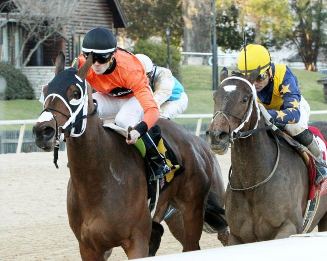 Marquee Miss (orange silks) edges favorite Nickname in 2/6 Martha Washington for 3-year-old fillies at Oaklawn Park. (Coady Photography)