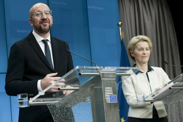 European Council President Charles Michel (left) and European Commission President Ursula von der Leyen (right) appeared at the end of the second day of a European Council summit Friday in Brussels. EU leaders gathered to discuss climate change, among other issues. Photo by Olivier Hoslet/EPA-EFE