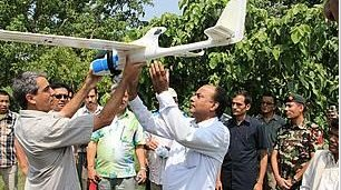 Serge Wich, one of the developers of the drone, explains its features to Nepal's Minister of Forests and Soil Conservation Yadu Bansa Jha. Credit: WWF Nepal