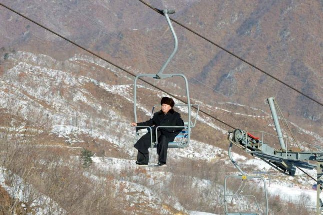 North Korean leader Kim Jong Un taking a ski lift at Masikryong Ski Resort in 2013. North Korean sports ministry officials were exempt from mandatory donations until 2013, as construction was underway at Masikryong Ski Resort and at other athletic facilities. File Photo by Rodong Sinmun/Yonhap