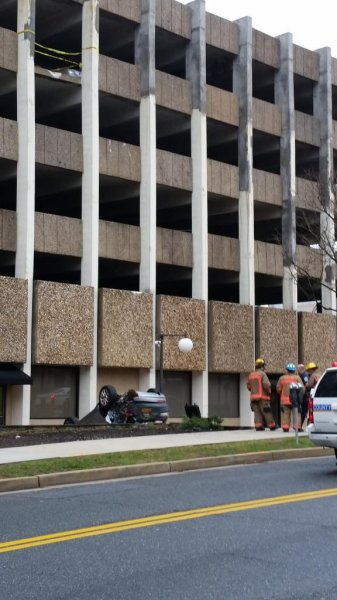 SUV falls four stories onto its roof, driver not seriously injured