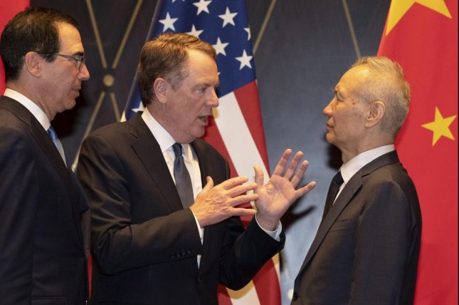 U.S. Trade Representative Robert Lighthizer (C) speaks with Chinese Vice Premier Liu He during talks July 31 at the Xijiao Conference Center in Shanghai, China. File Photo by Nh Han Guan/EPA-EFE