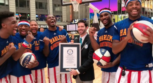 Six members of the Harlem Globetrotters made 348 half court shots in one hour to set a Guinness World Record. Screen capture/Guinness World Records