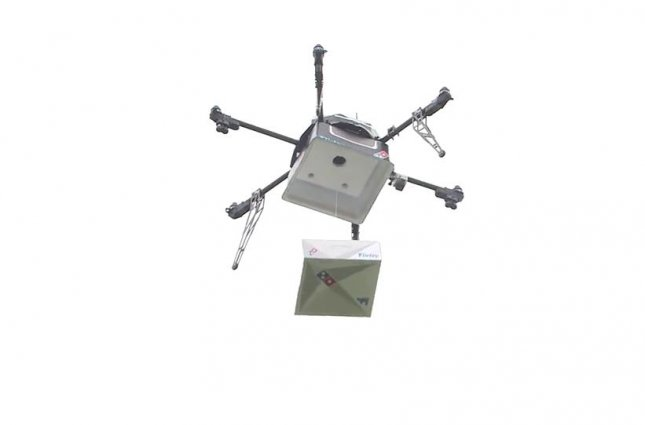 Domino's New Zealand delivered its first pizza by drone with the help of drone delivery company Flirtey. The drone carried the pizza box from a string before lowering it to Domino's Group CEO Don Meij, New Zealand Minister for Transport Simon Bridges and Flirtey CEO Matt Sweeny. Screen capture/Domino's New Zealand/Facebook