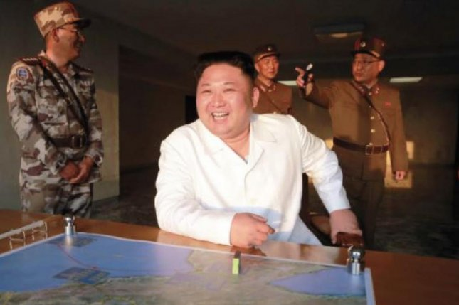 Recent photographs of Kim Jong Un from North Korea state media show him with a transdermal patch affixed to his chest, as he watches the firing of a short-range ballistic missile on Monday, local time. File Photo by Rodong Sinmun