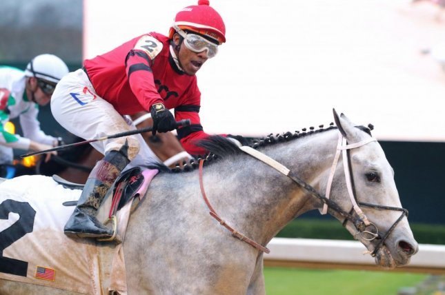 Silver Prospector, with Ricardo Santana Jr. riding, wins Monday's Southwest Stakes at Oaklawn Park, earning 10 points toward a potential start in the Kentucky Derby. Photo courtesy of Oaklawn Park