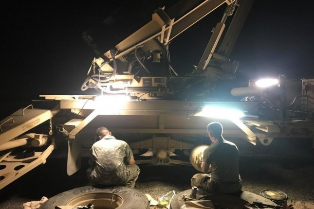 Two soldiers conduct equipment services in July July 2018 in Camp Beuhring, Kuwait, during Patriot Maintenance Sustainment Program operations. Photo by Allen Cain/U.S. Army