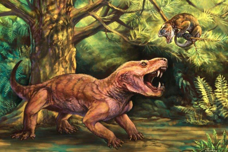 An artistic rendering shows a therocephalian Gorynychus masyutinae, an apex predator during the mid-Permian, treeing a small herbivore, Suminia getmanovi. Photo by Matt Celeskey/
