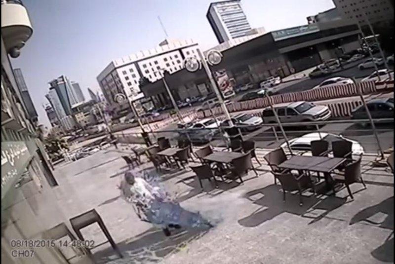 Saudi man evades serious injury from falling glass pane