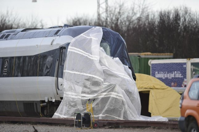 The passenger train involved in the Great Belt Bridge fatal accident is covered in Nyborg, Denmark, Thursday. Photo by Mads Claus Rasmussen/EPA-EFE